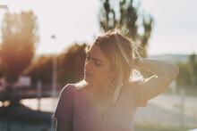 Portrait Of A Blonde Girl Enjoying The Sunset.