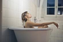 Youn Beautiful Woman Relaxed In Bathtub