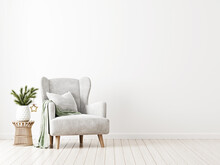 Simple And Neutral Minimalist Christmas Interior Mockup With Grey Armchair, Green Throw And Fir Tree Branch In Vase On Wicker Rattan Table On Empty White Wall Background. 3d Rendering, Illustration.