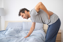 One Man Waking Up And Suffering From Backache