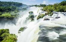 Aerial View Of Iguazu Falls From The Brazilian Side In Sunny Day With Blue Sky