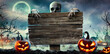 Leinwandbild Motiv Halloween Card Party - Pumpkins And Zombies In Graveyard With Wooden Board