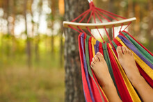 Foot Of A Child Lying In The Hammock And Relaxing