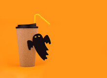 Eco-friendly Glass With Lid And Flying Black Little Ghost On An Orange Background