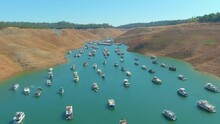 2021 - Amazing Aerial Over Drought Stricken California Lake Oroville With Low Water Levels, Receding Shoreline And Stranded Houseboats.