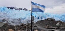 Flag Of Argentina On Ice Of Perito Moreno Glacier.