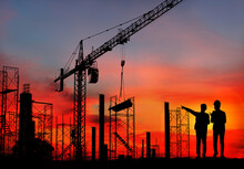 Silhouette Engineer Standing Orders For Construction Crews And Excavator And Machinery In An Outdoor Mine Work On High Ground Heavy Industry And Safety Concept