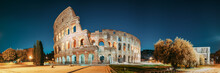 Rome, Italy. Colosseum Also Known As Flavian Amphitheatre In Evening Or Night Time.