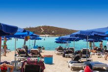Beach Umbrellas And Sunbeds On Sandy Beach In Ayia Napa, Cyprus