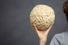 Young Woman Hold An Angled Yarn Ball Of Thread. Critical Thinking, Problem Solving And Psychotherapy Concept