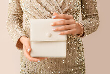 Fashionable Young Woman With Beautiful Manicure Holding Stylish Handbag On Color Background