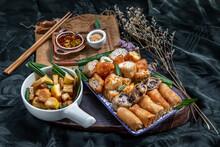 Many Vegetarian Food : Fried Taro Rolls (Taro Guangjian) And Deep Fried Spring Rolls, Tofu, Radish, Taro And Black Beans (Zhu Jiao Quan Or Fried Taro Cakes) With Spicy Sweet Sauce, Crushed Peanuts.