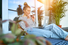 Working From Home. Woman Talking On Video Call With Family, Using Laptop And Drinking Tea. Online Chat. Spend Free Time On Terrace. Staying Connected, Social Distancing, Internet, Chatting..