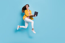 Full Body Profile Side Photo Of Young Woman Happy Positive Smile Jump Up Go Run Hold Laptop Isolated Over Blue Color Background