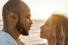 Portrait Of Happy Young Couple In Love Embracing Each Other On Beach