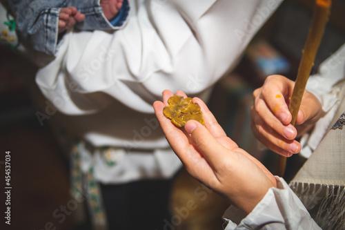 Fotografie, Obraz Traditional baptizing event in the church