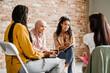 Leinwandbild Motiv Multiracial young women discussing project during meeting
