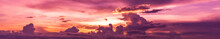 Colorful Sky With Sun In Clouds Of Altitude.panorama Scenic Of The Strong Sunrise With Silver Lining And Cloud On The Orange Sky.
