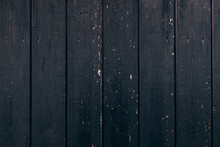Cropped View Of The Black Vintage Wood Background Texture Of The Fence With Knots And Holes. Objects Concept. Stock Photo