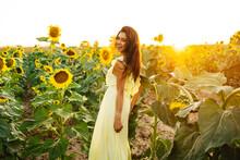 Woman In Yellow Dress In Sunflower Field