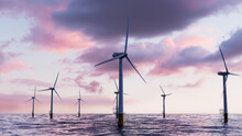 Wind Power. Offshore Wind Turbines At Dusk. Renewable Energy Concept.
