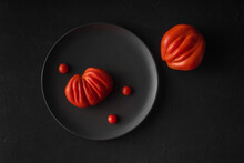 Big Tasty Ripe Ugly Farm Tomatoes On Black Background. Natural Healthy Vegetables Concept. Minimalistic Food Composition Flat Lay