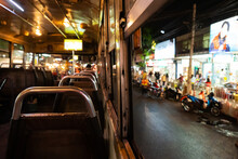 Ride In An Empty Bus Through The City At Night. City Bus Interior. Public Transport In Bangkok