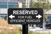 RESERVED For Fuel Efficient Vehicles Sign. Parking Is Reserved For Electric, EV And Hybrid Electric Vehicles In An Effort To Promote Green And Clean Driving.