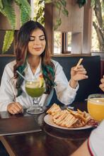 Latin Woman Takin A Fries Potato