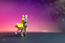 Miniature People , Couple Dancing With Colorful  Background