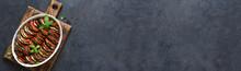 Vegetable Ratatouille On A Black Concrete Background, Top View.