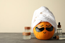 Concept Of Body Care With Pumpkin On Gray Textured Table