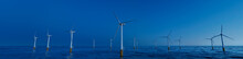 Wind Power. Offshore Wind Turbines On A Clear Evening. Sustainable Energy Concept.