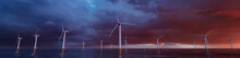 Wind Turbines. Offshore Wind Farm On A Stormy Evening. Clean Electricity Concept.