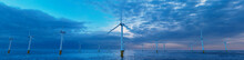 Wind Power. Offshore Wind Turbines On A Cloudy Afternoon. Environmental Energy Concept.