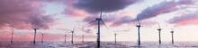 Wind Power. Offshore Wind Turbines At Dusk. Renewable Electricity Concept.