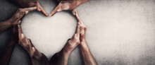 Different People Unite For A Common Purpose As Diverse Person Hands Join Together And Create Heart Shape, Isolated On Grey Wall Background With Copy Space. Race Diversity And Love An Teamwork Concept