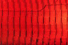 赤い光に照らされた大谷石を切り出した後の採掘場の石壁、背景素材