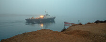 Charter Fishing Boat Leaving  Morro Bay Harbor In The Morning Fog On The Central Coast Of California United States