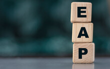 EAP - Acronym On Wooden Cubes On A Blurr Gray Background