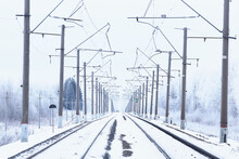Winter Railway Landscape, View Of The Rails And Wires Of The Railway, Winter Delivery Way