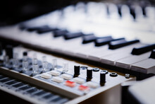 Synthesizer Device In Sound Recording Studio. Professional Midi Controller Synth For Composer. Produce New Electronic Music Track With Drum Machine