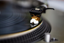 Dj Turntable Player. Turntables Needle Playing Music From Analog Vinyl Records On Hip Hop Party. Professional Disc Jockey Audio Equipment. High Fidelity Sound System For Sound Enthusiast