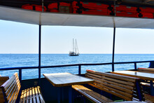 Beautiful View Of The Yacht In The Sea From The Ship With Benches And Tables. Crimea, August 2021.