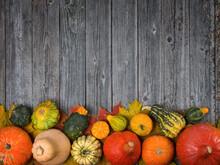 Different Pumpkins On A Wooden Background, Autumn Theme, Texture. Design Ideas, Top View