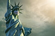 Statue Of Liberty Is Wear Mask. Coronavirus In The United States.