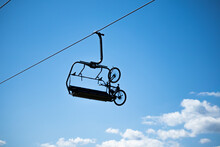 Fixed Bike On Empty Chairlift With Blus Sky On Background