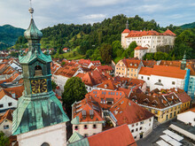 Skofja Loka In Slovenia. Medieval Old Town, Bell Tower And Castle. Drone View
