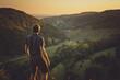 Leinwandbild Motiv Sportlicher junger Wanderer im Sonnenuntergang in Oberfranken in den hügeligen Wäldern