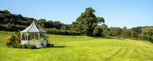 South Devon, England, UK. 2021.  Garden Gazebo With Surrounding Shrubs In English Rural Countryside